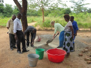 Peggy helping to mix cement for a filter