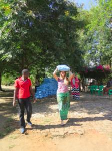 Sarah distributing maize
