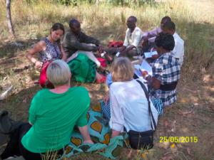 Team Meeting in grass Malawi Trip 2015