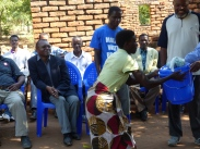 Conscientious villager receiving a prize