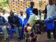 Conscientious villager receiving a prize